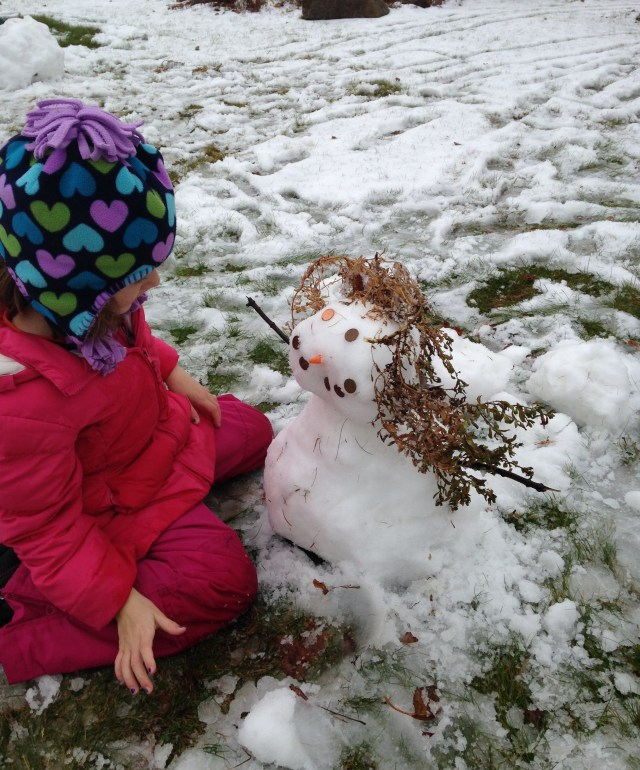 a kid sized snowman