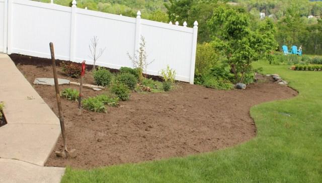 fresh soil in flower bed