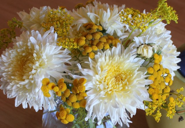 cream flower arrangement with chrysanthemums